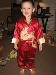 Steven brought Jax a traditional outfit that chinese boys wear on New Years