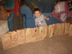 Jaxon showing off his art work on the treat bags for his party...of course he had to try out one of the treats!