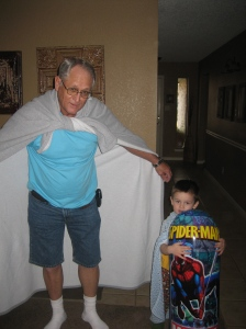 playing superheros with pop while mom and nana bake the cake and cupcakes.