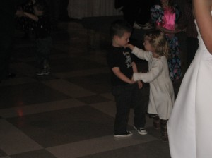 Paige and Jaxon at Liz's wedding...Paige is trying to teach Jax a little about a girl's world