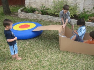 Jaxon with some neighborhood friends...figuring out what cool stunts they can do with a blowup trampoline and a big box!